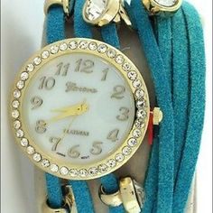 Geneva Three String Leather Wrap Watch Geneva Three String Turquoise Leather Wrap Watch. Rhinestones and metalic buttons attached to strap. Triple wrap watch band  is 22″ long Geneva  Accessories Watches