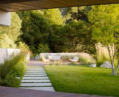 long pavers on grass - bernard trainor plastolux modern garden lanscaping design
