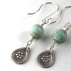 Floral teardrop earrings by Penny Ann Keller Herring.