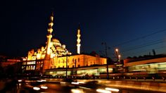A train passes the 17th century Ottoman era mosque Yeni Cami (New Mosque) in downtown Istanbul.