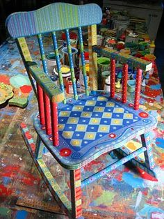 """Painting It: chairs  The rocker is vintage. It has a damaged, no longer functioning music box on the back. The client asked me to leave it, and not paint it, I also left the vintage """"Stork"""" label unpainted"""