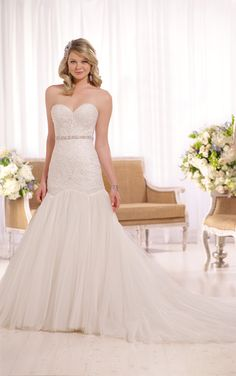 Your Dream Bridal // Spring 2016 Curve-hugging linear lace on a plunging bodice make this stunning fit-and-flare wedding dress from Essense of Australia a top pick for the perfect wedding. http://www.yourdreambridal.com