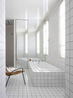 Master bath in Paris loft on Passage Charles Dallery designed by Regis Larroque.An all-encompassing grid of white tiles with gray grout in the guest room's companion bath. Bad Inspiration, Bathroom Inspiration, Bathroom Trends, Bathroom Interior, Rental Bathroom, Bathroom Ideas, Design Bathroom, Parisian Bathroom, Bathroom Stuff