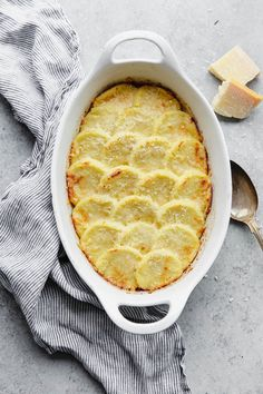 Gnocchi Alla Romana made with semolina flour, parmesan cheese, milk, and butter. A delicious, cheesy, and traditional Italian side dish! Semolina flour is cooked on the stovetop, spread into a thin layer and cooled, cut into rounds, topped with cheese, and baked in the oven. Serve semolina gnocchi with warm tomato sauce, roasted vegetables, or as a side to traditional proteins!