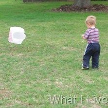 Plastic bag kites! We used to do this all the time....And on really windy days mom would even let us use the big black trash bags.