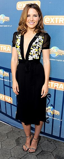Va va voom! Sophia Bush turned heads in a plunging LBD with floral details at the bodice. She paired the frock with lace heels.
