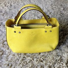 """Yellow Leather Kate Spade Handbag Used but in good condition. 10"""" L x 5.5"""" H x 3"""" W kate spade Bags"""