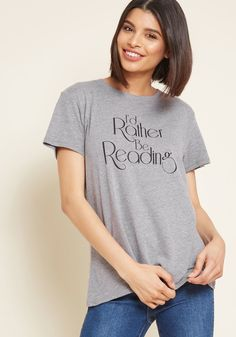 If you can't be wrapped up in an intriguing book, then you can be sporting this grey graphic tee! Atop the loose, comfortable fit of this soft T-shirt, a...