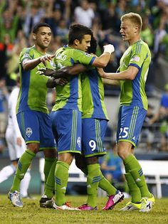 Teammates congratulate Sounders FC midfielder Servando Carrasco after he scored on a penalty kick in the second half against the Vancouver Whitecaps. Photo by John Lok / The Seattle Times