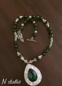 Jade necklace with German silver pendent