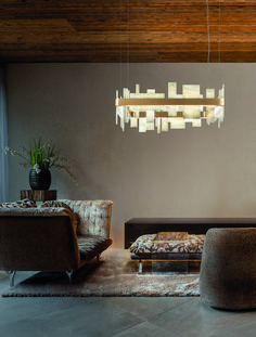 This is a Beautiful Geometric Ceiling Pendant in the formation of a square. It features a metal frame in opaque gold finishing and a natural onyx diffusor and an LED lighting system. It is available in two sizes, 80cm and 50cm. It is readily available in one finish; painted matt gold. However it can be made in other finishes upon request however there will be a slight price increase.