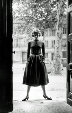 """Audrey in design by Givenchy, shoes by Renè Mancini, photo by Mark Shaw for publicity of """"Love in the Afternoon"""", Paris (France), Winter 1956/57"""