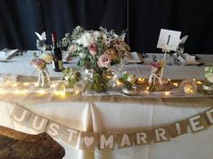 Top table dressed with jars and fishbowl plus a just married sign. The Garden Studio www.gardenstudioevents.co.uk Find us on Facebook!