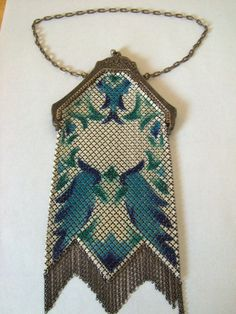 "Mandalian Mfg. Co. Metal Mesh Evening or Flapper Purse. This is a flapper or evening purse from the 1920's or 30's. The vibrant colors are in cream and teal with blue and green accents. Marked on the inside of the frame ""Mandalian Mfg. Co."". Measures 8"" tall from the top of the latch to the bottom of the fringe and 3 5/8"" wide across latch."