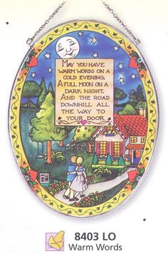 """The Warm Words Sun Catcher is a large oval shape. It measures 6 1/2"""" x 9"""". The inscription reads: May You Have Warm Words On A Cold Evening. A Full Moon On A Dark Night And The Road Down Hill All The"""