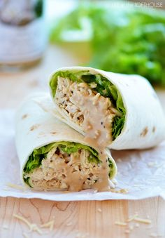 Crock Pot Chicken Caesar Wraps _ With really outstanding flavor! All you need for this heavenly wrap is large flour tortillas, ( a spinach tortilla would be even better!) green leaf lettuce, shredded Parmesan cheese & the Caesar chicken. It is super yummy!