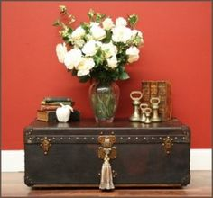 love these antique trunks for decor