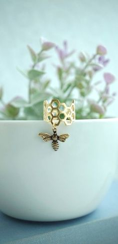 Tiny Bee and Honey Comb Ring, Bee Lover Gift. Adjustable Ring, Bee Jewelry, Flying Bee, Woodland Bee, Fall, Christmas Gift, Honey Comb Ring by Marolsha - https://www.etsy.com/listing/247086724/tiny-bee-and-honey-comb-ring-bee-lover?ref=shop_home_active_13