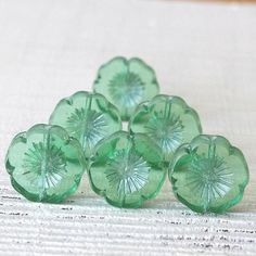 Pretty little 10mm acrylic flowers in Greens and Blues