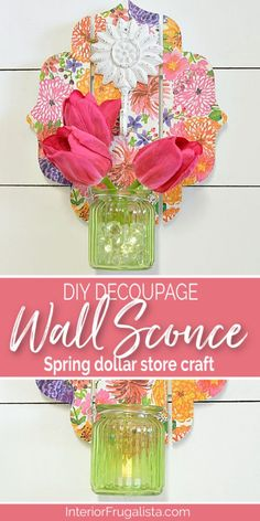 This DIY Decoupage Wall Sconce is an easy dollar store craft for Spring or Summer and can be used as a mason jar candle holder lantern or hanging flower vase. Includes step-by-step decoupage instructions by Interior Frugalista  #dollarstorecraft #springdecor #diywallsconce #candleholder #hangingflowervase #decoupageideas