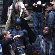Love this...Bane is helping Batman with his cape..like a good gentleman. :)