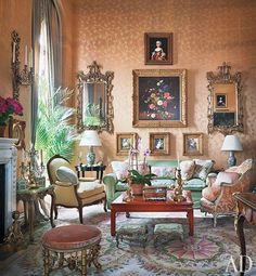 The ballroom features Mehle's collection of 18th- and 19th-century mirrors and paintings, which overlook a Chinese low table by Gracie, an 18th-century Italian bergère (at right), and a sofa whose pillows are made of Scalamandré floral prints.