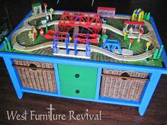 DIY train table. Use an activity rug as the top. Awesome idea