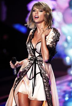 Taylor Swift performing at the VS Fashion Show in London 2014
