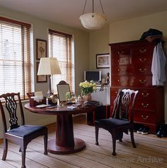 Malcolm James Kutner ~ The masculine dressing room is furnished with a mahogany table by Philippe Hurel, an 18th century English chest-on-chest and an alabaster light fixture by Robert Kime