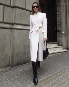 Classic, beautiful white belted coat from Karen Millan with knee high black boots. @karen_millen. Image may contain: 1 person, standing and shoes. Minimal Fashion, Timeless Fashion, White Coat Outfit, White Belt, Cute Winter Outfits, Belted Coat, Winter Trends, Pics Art, Karen Millen