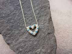 Elisa Solomon Jewelry 18 karat yellow gold open heart necklace with turquoise and diamonds