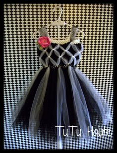 This adorable tutu dress has been created from the softest black and white wedding tulle. The dress features a woven bodice, empire waist and hand made satin rose in bright pink.  * Please list your desired size at checkout. This listing is available in little girls sizes 2T to 4T. * Dress is not lined but is very full..... it is recommended to wear a romper or shorts underneath or coverage.  *** $55.00