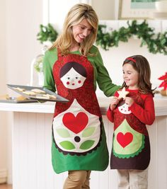 Kerrie -how fun would these be????? These Matryoshka Doll Aprons are great for holiday baking! #fabulouslyfestive