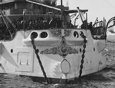 Close-up of the ornate bow and torpedo tube of USS Indiana.