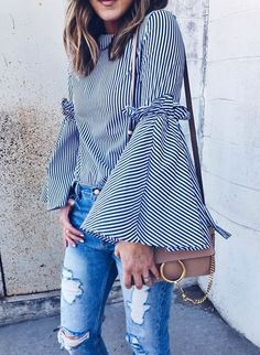 This spring, pair a striped bell-sleeved top with ripped denim and a cute cross body bag. Let Daily Dress Me help you find the perfect outfit for whatever the weather! dailydressme.com/