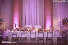 Purple tablescape with soft linens and antler centerpiece
