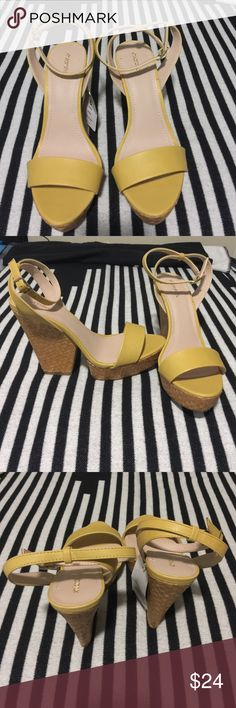 Yellow wedge heels Yellow wedge heels with toe strap and ankle strap. Bottom wedged is made of woven material. Brand-new with tags, perfect for a wedding! Xhilaration Shoes Wedges