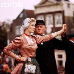 The pinner said;I love cultural dances like these. I don't know anything about Norwegian dancing. These are Dutch Folk Dancers A couple performs folk dances on an outdoor stage in Schagen, Netherlands. Cultural Dance, Outdoor Stage, Music Licensing, Folk Dance, Dance The Night Away, Dance Costumes, Traditional Outfits, Royalty Free Photos, Netherlands