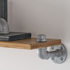 Aged pickled wood shelf with steel pipe finish