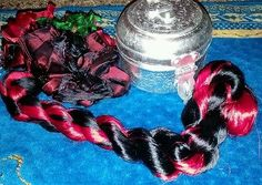 red and black thrum silk for spinning, art batts and rolags.measures 20in.
