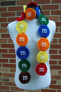 "M and M Candy Scarf:  ""Ms"" made and fused with felt and permanent, washable fabric glue. Scarf measures 70"" long, consists of 18 M candies"
