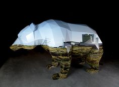Wandering Territory - Anna Garforth - A digital model of a bear was converted into a 3D printed cardboard sculpture. It's polygon sides create the contours of a landscape, illustrating the idea of migration. It represents the crossing of environments and a temporary shift in the daily landscape. The sculpture formed part of the exhibition 'Pop - up Culture' at The Design Museum in Holland. It was later bought by the museum and resides there as part of their permanent collection.