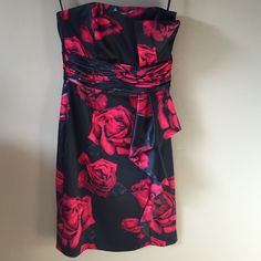 White House Black Market Strapless Dress Luscious black and red roses dress from WHBM. Strapless, back zipper, lined, boning. Pinned on size 6/8 mannequin. Check out the $6 section near the bottom of my closet (before the sold items) for lots of bundle-worthy $6 items! 15% bundle discount on 2+ items in a bundle. White House Black Market Dresses