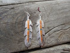 Beautiful feather earrings handmade in sterling silver with spiney oster and opal by Billyrebs on Etsy