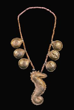 Sear horse necklace on coral  22 K gold Minangkabau Sumatra early 19th c Published in Walk in Splendor  and Necklaces from Sumtra to Hawaii (x private collection Linda Pastorino, archives  sold Singkiang)