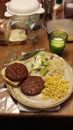Burgers, rice, corn and salad for supper