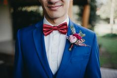 Cobalt blue suit and red bow tie