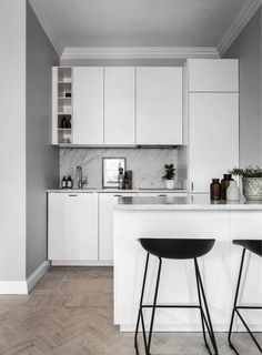 All white kitchen with wood floor. Small Grey Scandinavian Apartment - Gravity Home