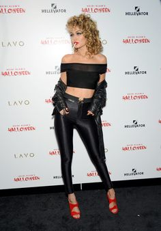 "Gigi Hadid made a great impression at Heidi Klum's Halloween party with her Sandy costume. Styled by Monica Rose, the Kardashian's stylist, ""she pulled it off with ease. Wearing nylon high-waisted spandex from American Apparel, a crop top with a sheer panel from House of CB, and a lace-up leather jacket by Caroline Blomst, the supermodel attracted all eyes — even when standing next to Heidi Klum or, erm, Jessica Rabbit herself!"" - Shemaia F."