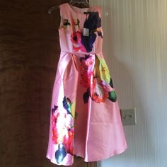 """Pink floral print sleeveless dress XS NWT HP😃🎉 Sleeveless pink dress w/large floral print and flare skirt is beautiful for spring and summer.  It is fully lined and SZ says S but fits smaller than a small so PLEASE LOOK AT MEASUREMENTS! I'm reposhing because it has NEVER FIT ME! (No matter how much I love it!) outer and lining feel like acetate (no fabric tab) center back zip. Length 41"""" length from waist down 27.5"""" waist 12.5"""" bust 15"""" (no stretch!) Dresses"""